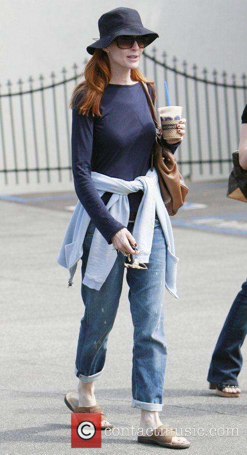 Marcia Cross gets an iced coffee while out...