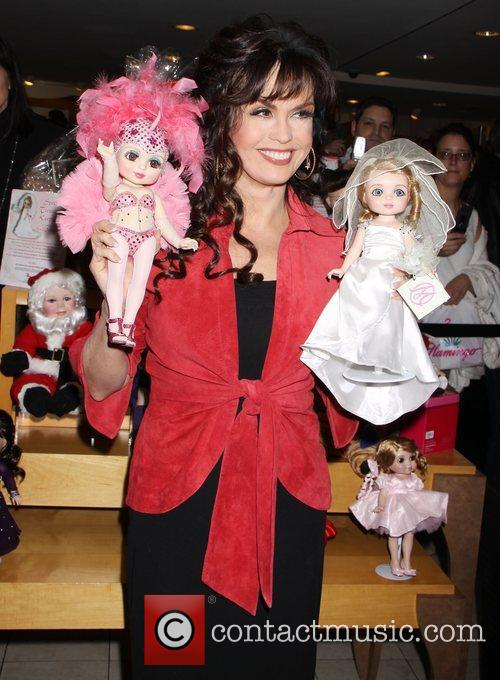 Marie Osmond held a Valentine's Day themed Doll...