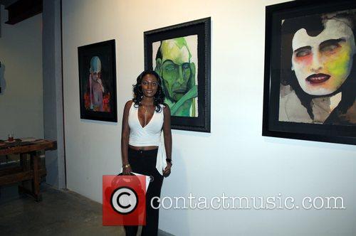 Fibi Love stands aside Marilyn Manson's art work...