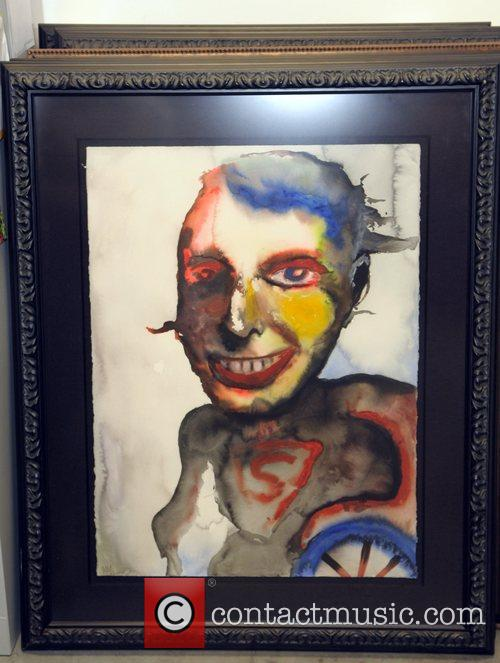 Marilyn Manson displays some of his art work...