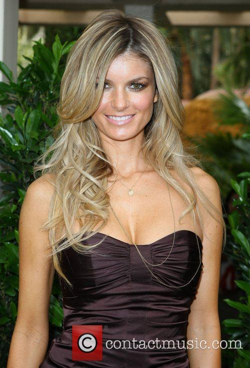Sports Illustrated cover model Marisa Miller signs autographs...