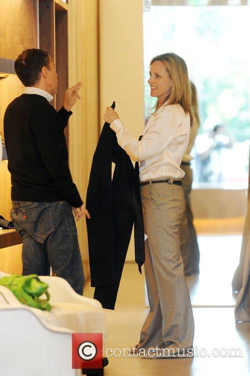 Academy Award-winning actress Marlee Matlin tries on clothes...