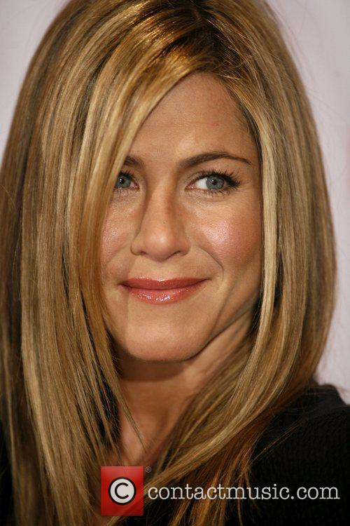 Jennifer Aniston attends a photocall for 'Marley &...