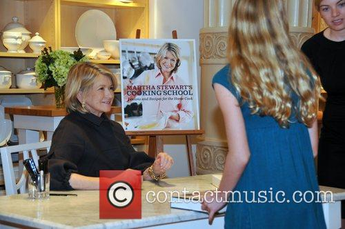 Signs copies of her new book, Martha Stewart's...
