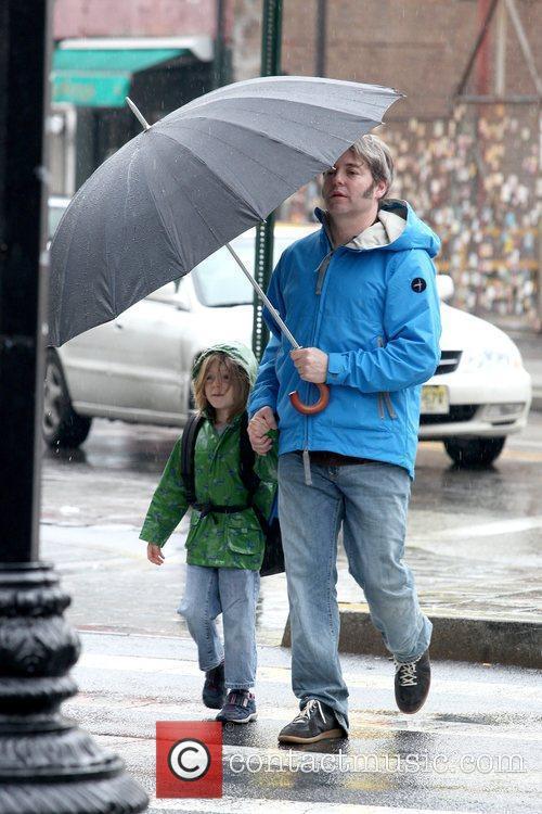 Walks his son, James Wilkie Broderick, to school...