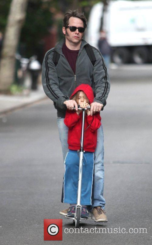 Plays the doting father as he takes son...