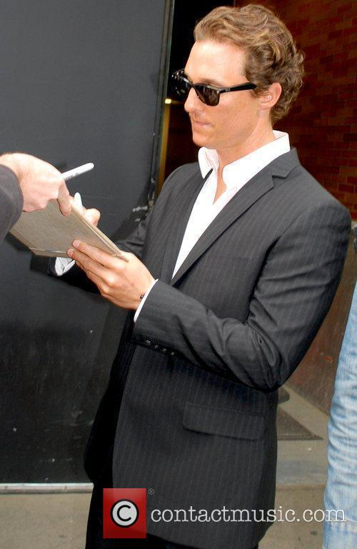 Matthew McConaughey signs autographs for fans while in...