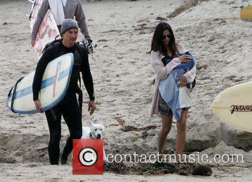 Take baby son Levi to Malibu beach