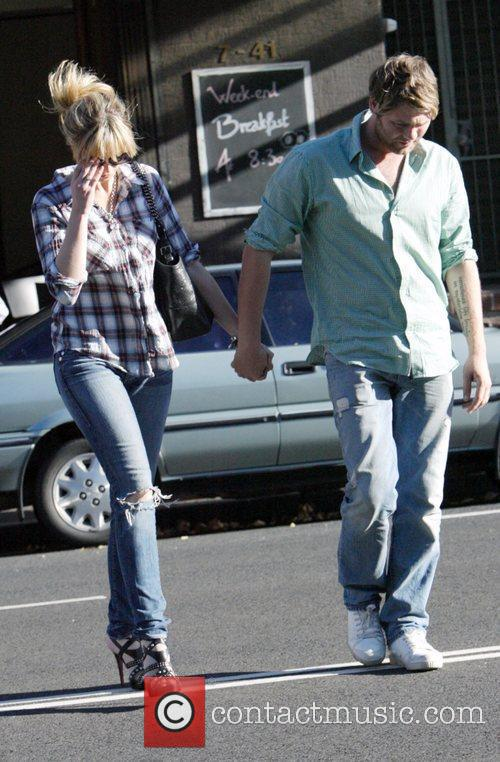 Walk back to their apartment together after a...
