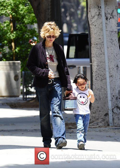 Meg Ryan picks up her adopted daughter, Daisy,...