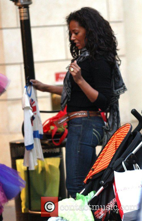 Mel B and Her Husband Go Christmas Shopping With Her Daughter At The Grove 10