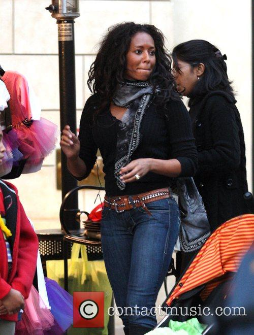 Mel B and Her Husband Go Christmas Shopping With Her Daughter At The Grove 11