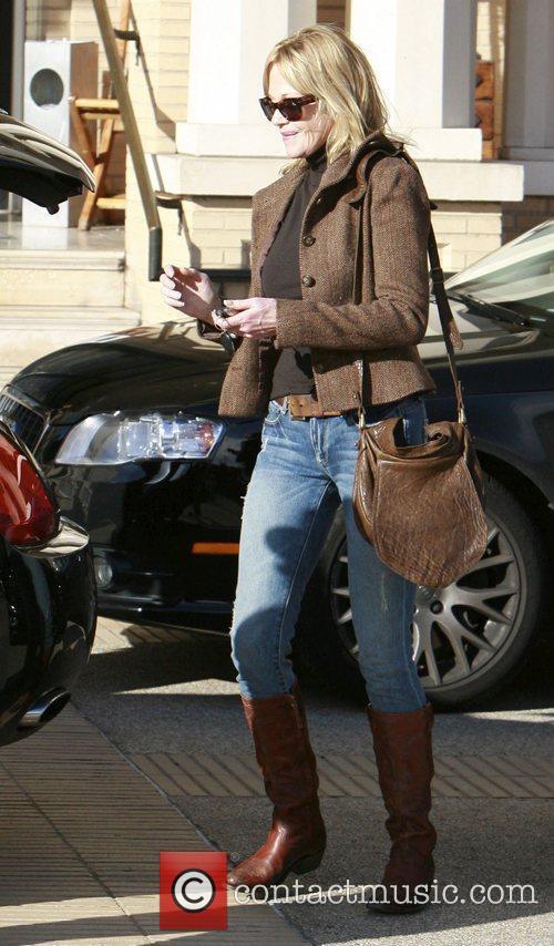 Melanie Griffith seen leaving Barneys New York in...