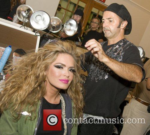 Celebrity model Cindy Taylor gets her hair done...