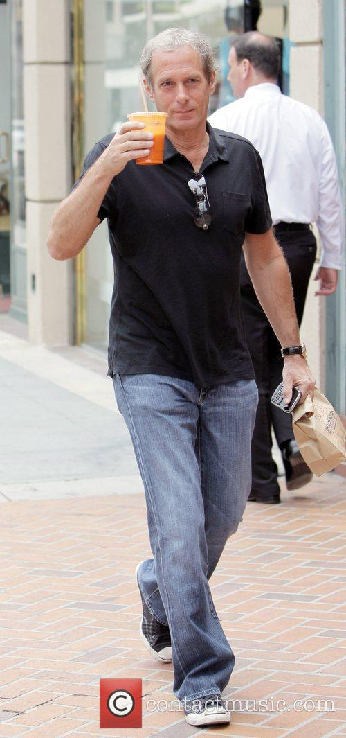 Michael Bolton carrying a bag of medication and...