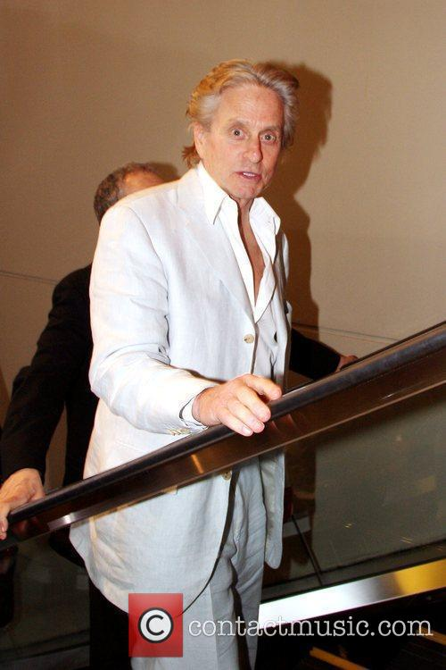 Michael Douglas leaving after attending the premiere of...