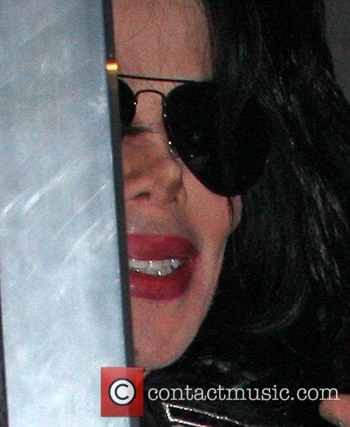 Michael Jackson looks out of his minbus