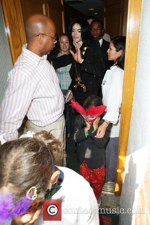 Michael Jackson  and his children, Blanket and...