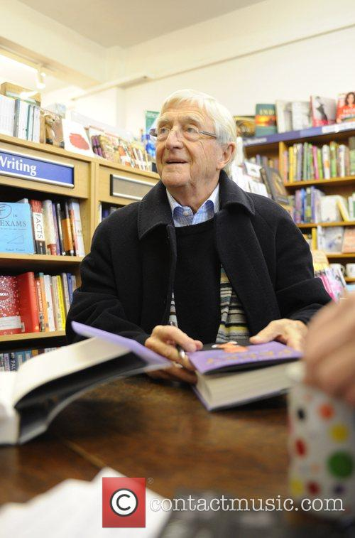 Signing copies of his book called 'Parky' at...