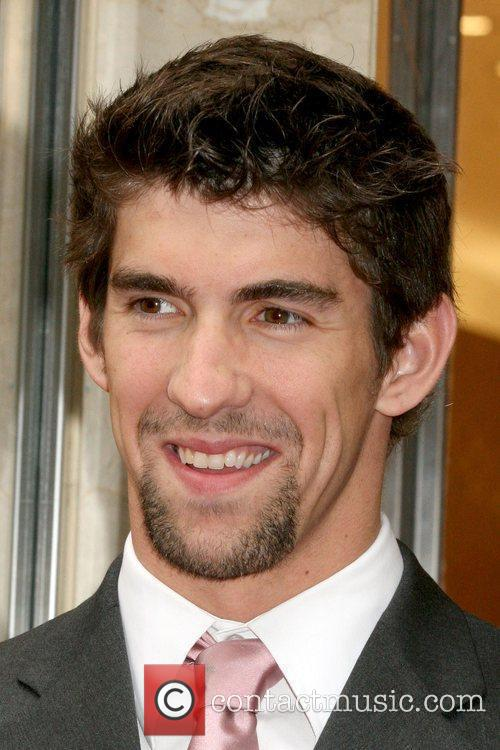 Olympic swimmer Michael Phelps opens the new OMEGA...