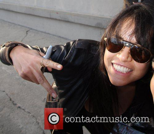 'Fast & Furious' star Michelle Rodriguez signs autographs...