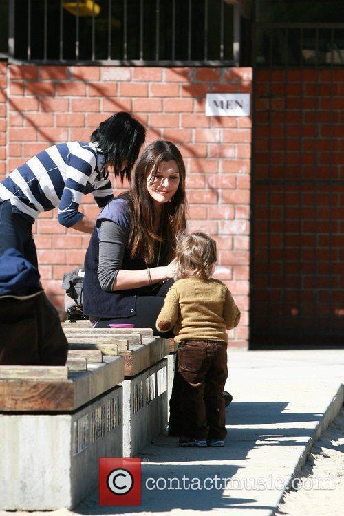 Mila Jovovich plays with her daughter Ever Gabo...