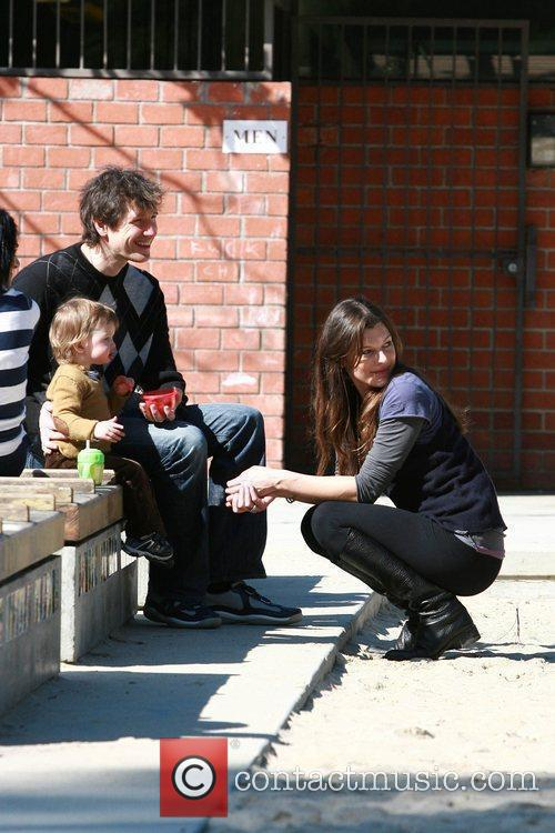 Paul W.S. Anderson and Mila Jovovich play with...