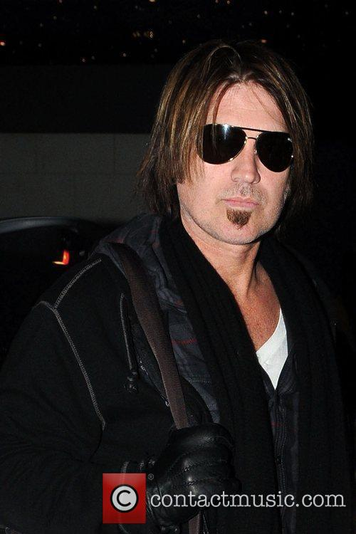 Billy Ray Cyrus poses for photographs as he...