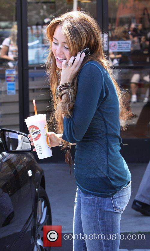 Miley Cyrus  talking on her mobile phone...
