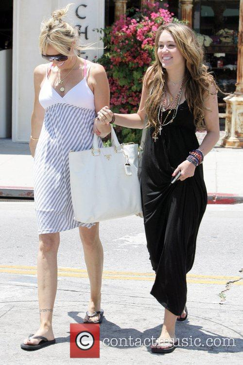 Miley Cyrus, Her Mother Tish Spend Saturday Afternoon Eating Lunch At The Studio Cafe, Shopping At M. Fredric Boutique and Royal Dutchess Boutique 3