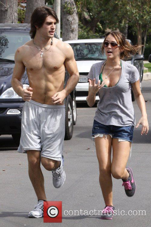 Miley Cyrus and Justin Gaston out running at...