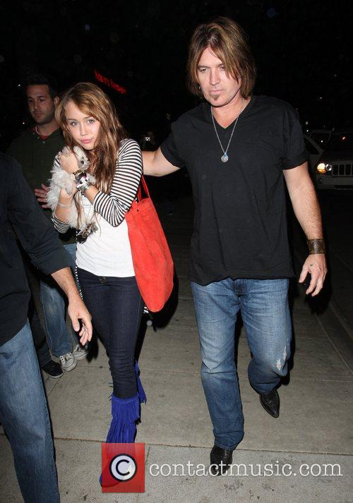 Miley Cyrus is taken by father Billy Ray...