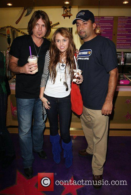 Billy Ray Cyrus, Miley Cyrus, and Guest at...