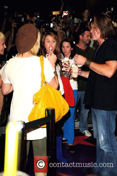 Miley Cyrus and Billy Ray Cyrus at Millions...
