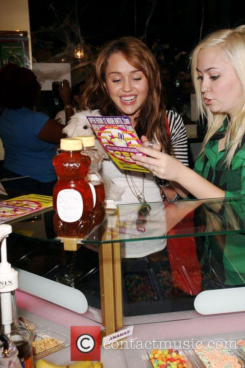 Miley Cyrus and friend at Millions of Milkshakes...