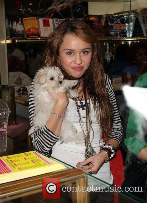 Miley Cyrus with her dog visits Millions of...