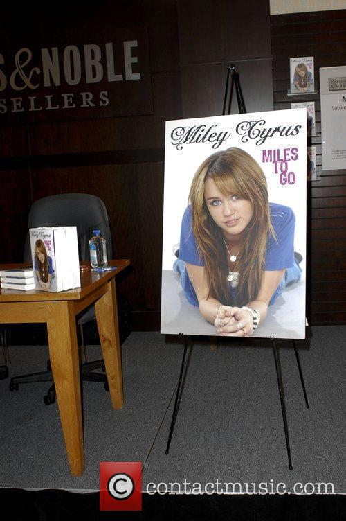 Atmosphere Miley Cyrus promotes her book, 'Miles To...