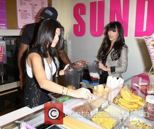 Kim Kardashian and Kourtney Kardashian At Millions Of Milkshakes 8