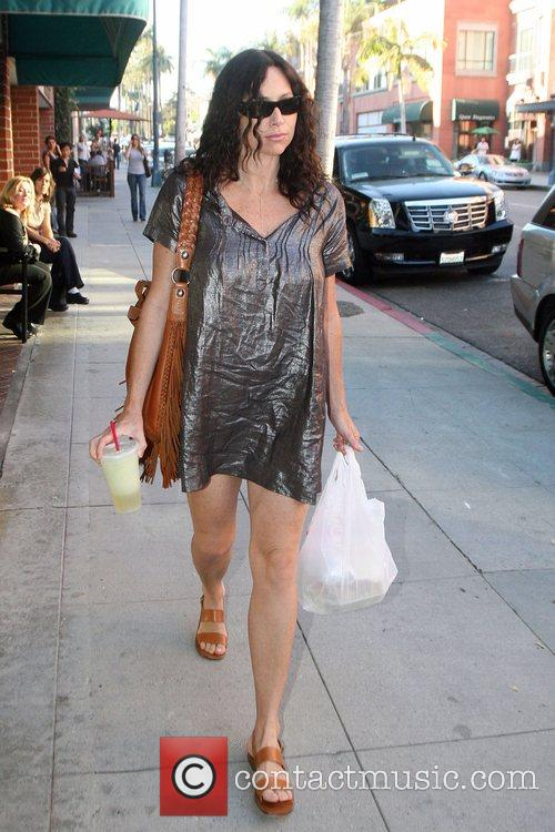 New mother Minnie Driver carries her lunch as...
