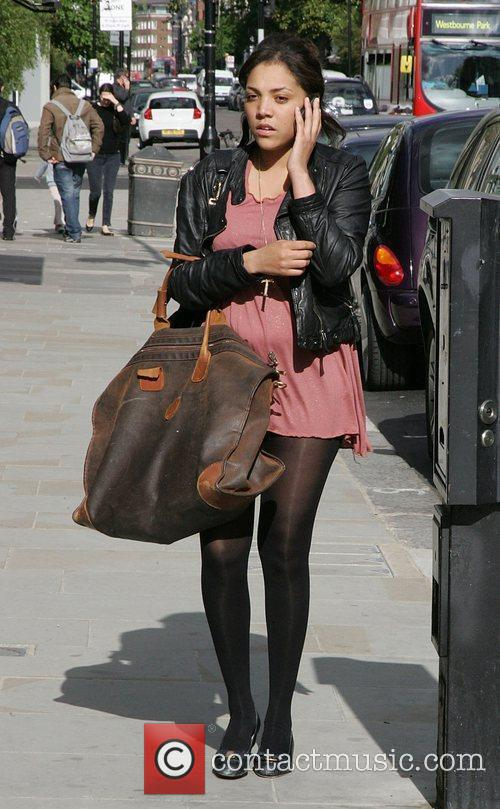 Looks very tired as she walks through Notting...