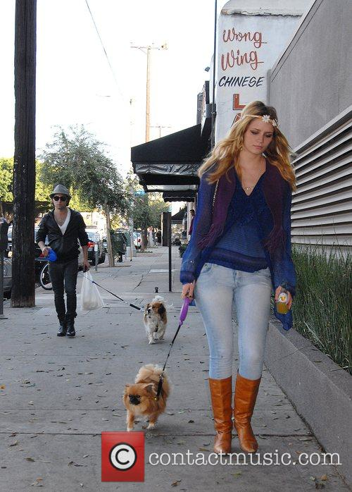 Walking her dog after having lunch with a...