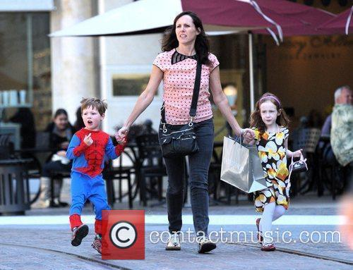 Takes her children Nolan, dressed as Spider-Man, and...