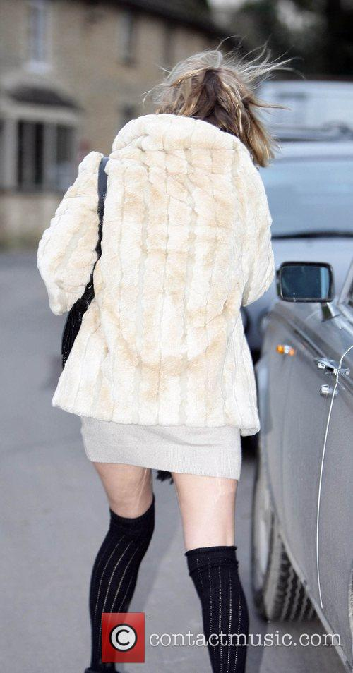 Kate Moss arriving at The Swan pub