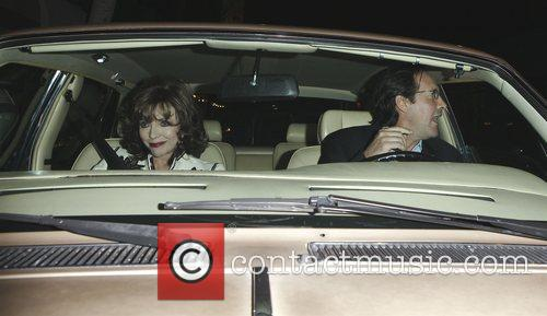 Joan Collins and Percy Gibson outside Mr Chow...