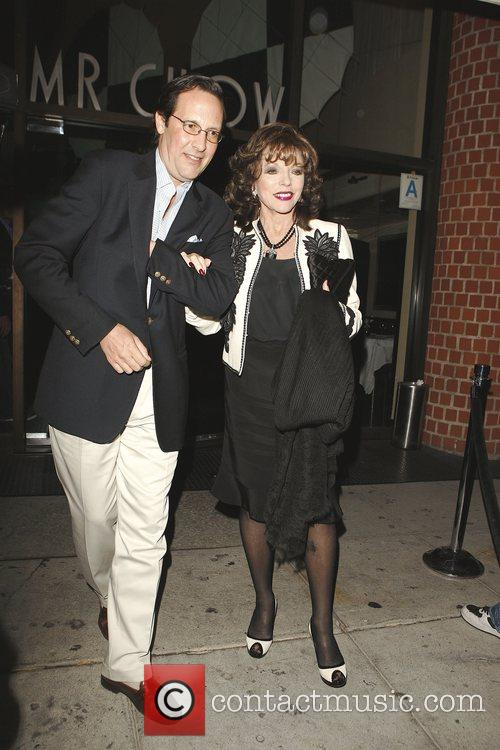 Percy Gibson and Joan Collins outside Mr Chow...