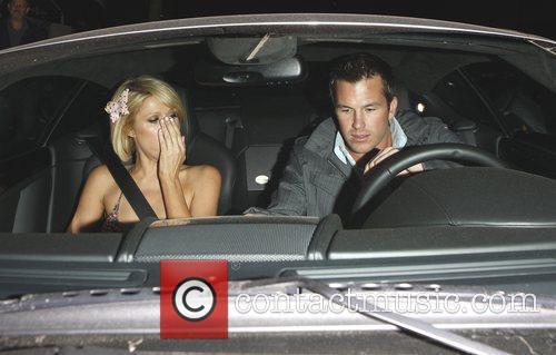Paris Hilton has to stifle a yawn as...