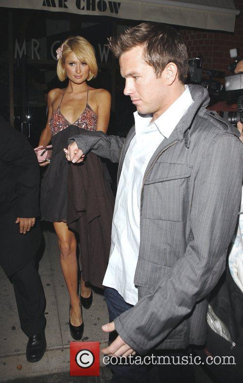 Holding hands as they leave Mr Chow restaurant...