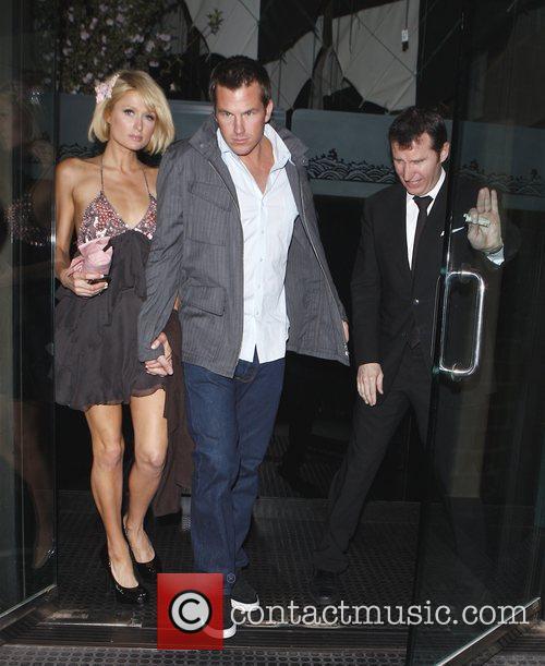 Paris Hilton and boyfriend Doug Reinhardt holding hands...