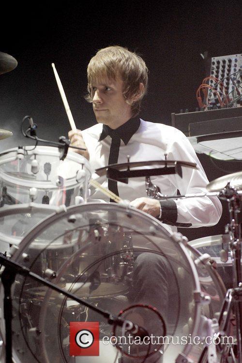 Dominic Howard of Muse performing at Wembley Arena