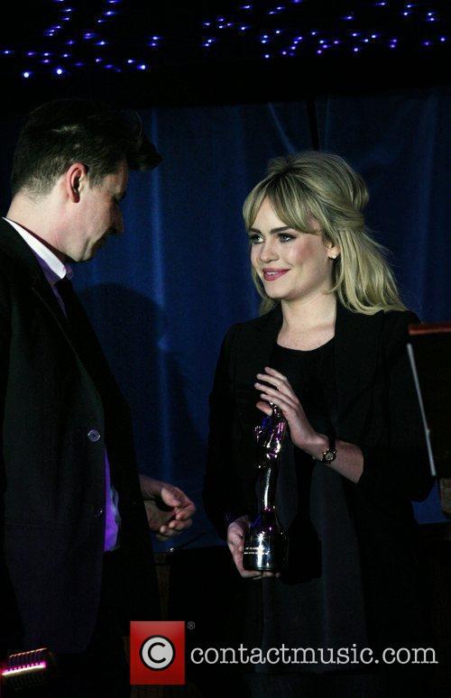 Bernard Butler accepts an award from Duffy The...